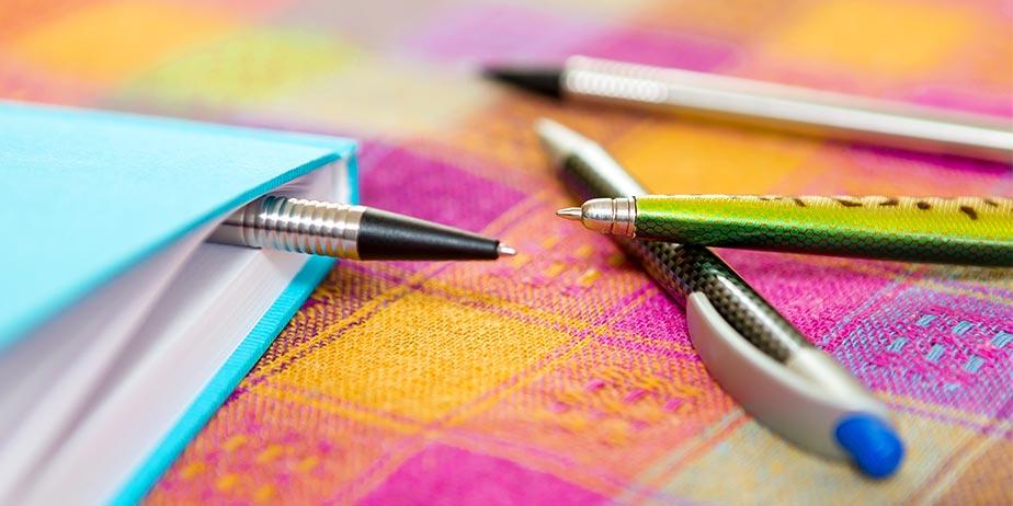 Stifte mit Notizbuch